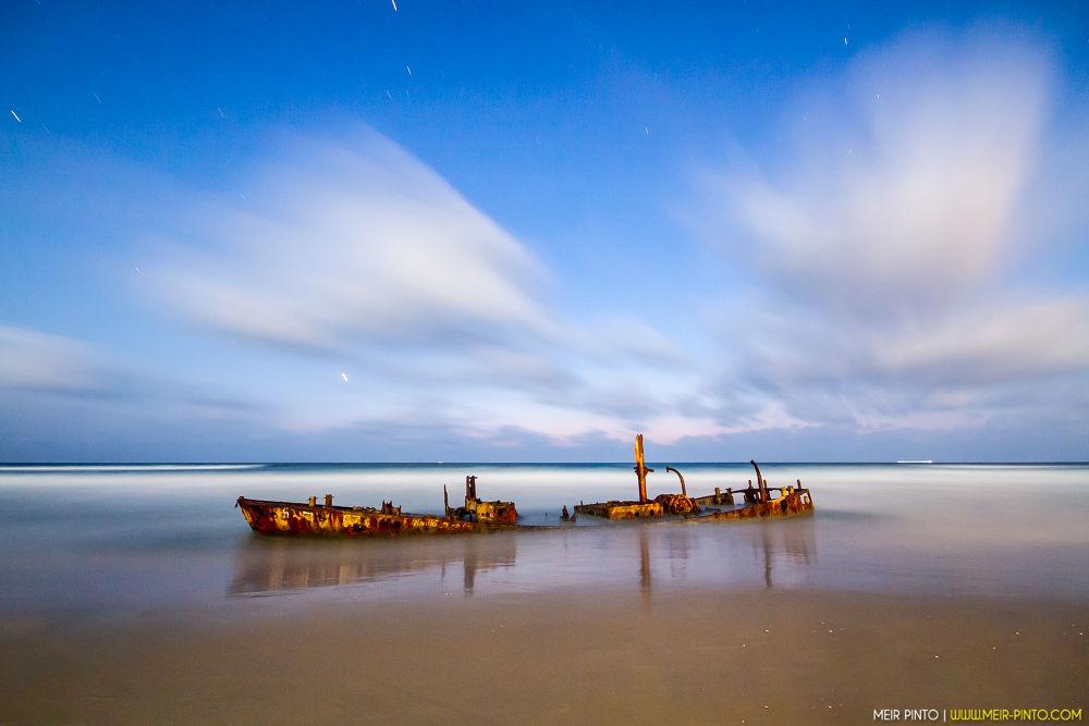 Photo in Random #ypa2013 abandoned beachnig #long exposure #night #beach #ypa2013 #ship #rust #sea #water #shore #clouds #reflection #stars #sky