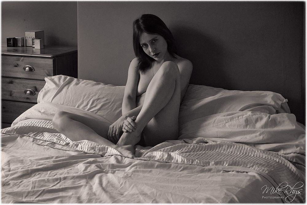 Photo in Black and White with model EvieK  #natural light #window light #concealed #covered #implied #nude #petite #female #bed #boudoir #woman #monochrome #black and white #mikerhys #eviek