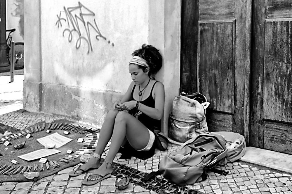Photo in Random #woman #working #crafts #street #street vendor #blackandwhite