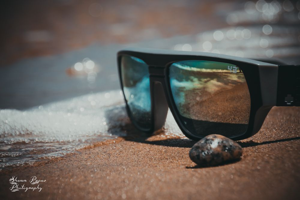Photo in Product #beach #sunglases #sand #product #sale #ad #advert