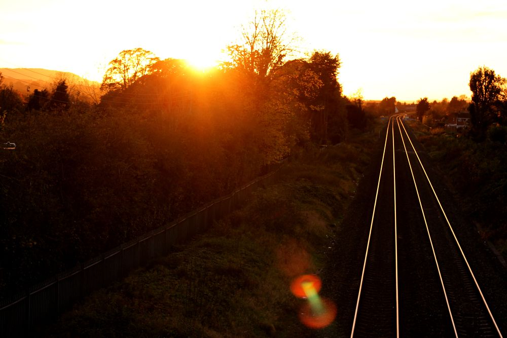 Photo in Landscape #sun #train #sun rays #landscape #aesthetic #lines #pattern #nature #man made