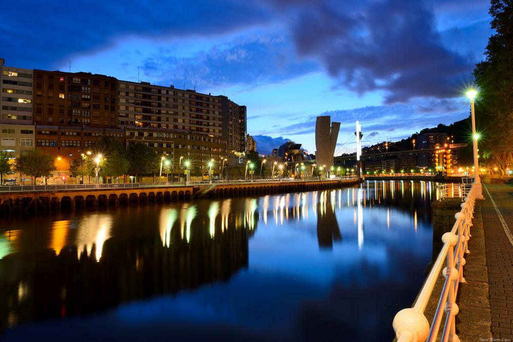 Photo in Cityscape #blue hour #hora azul #nocturnal #nocturna #bilbao #pais vasco #lights #luces #guggenheim #bilbo #salve bridge #puente de la salve