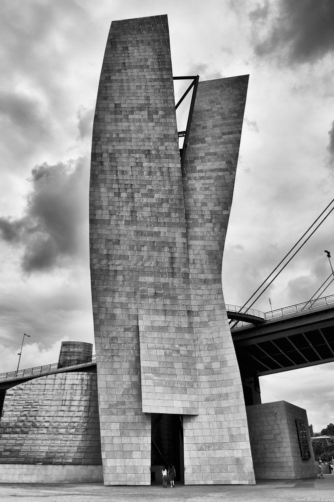 Photo in Random #bilbao bilbo black and white #city #ciudad #blanco y negro #building #clouds #edificio #nubes #gente #guggenheim #museo #museum #pais vasco #portal #people