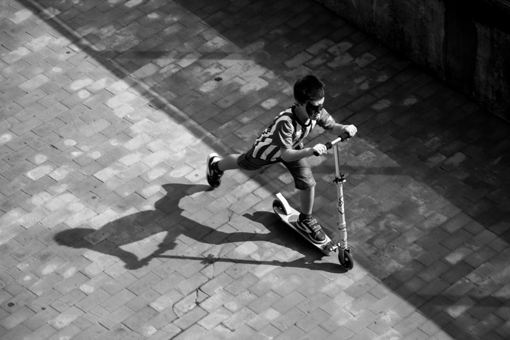 Photo in Street Photography #kid #batman #skate #shadow #athletic #step #run #racing #geometry #street #street photography