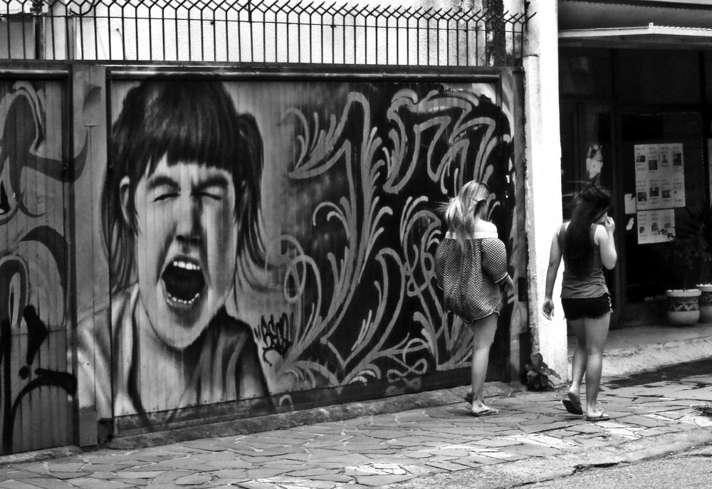 Photo in Street Photography #graffiti #street photography #street #girls on the street #people #black and white #street art