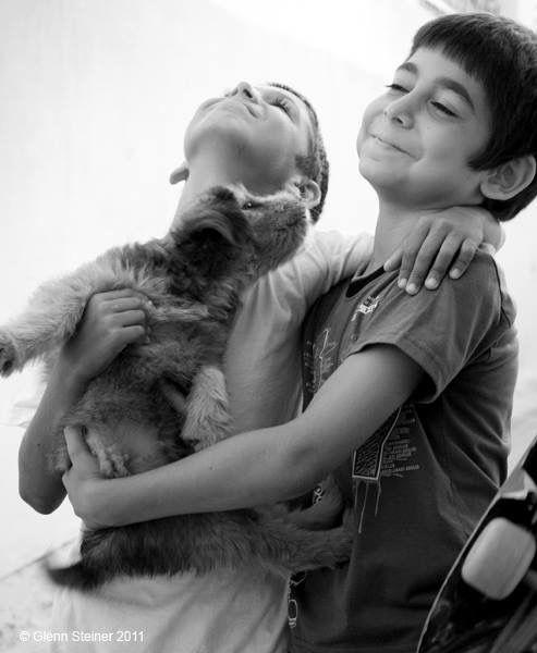 Photo in Street Photography #dogs #family #boys #greekislands #santorini #bw #bnw #bnw_world #adorenoir #glennsteiner #greekislandphotography #love #unconditionallove #fira #oia
