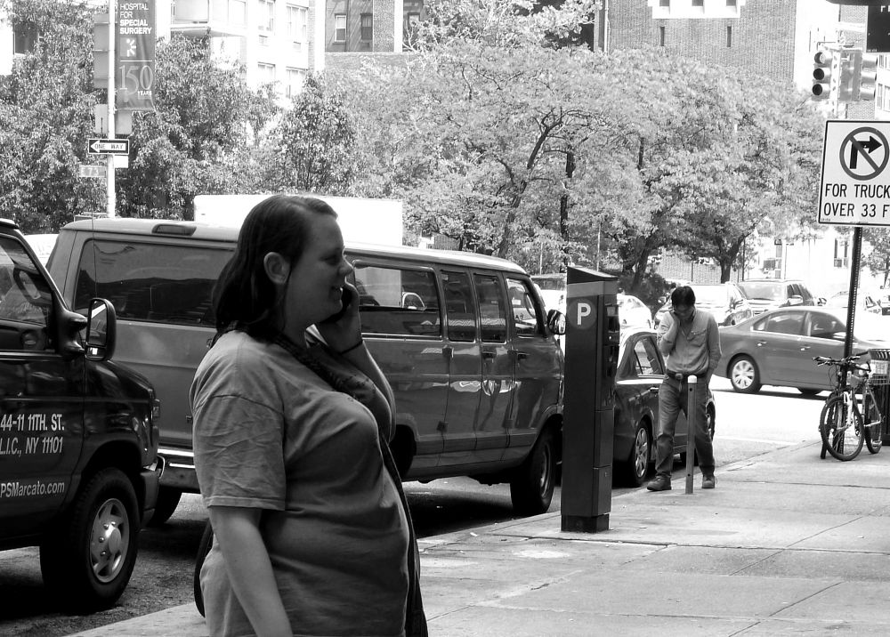 Photo in Random #black & white #street #man and woman #cell phones #new york city