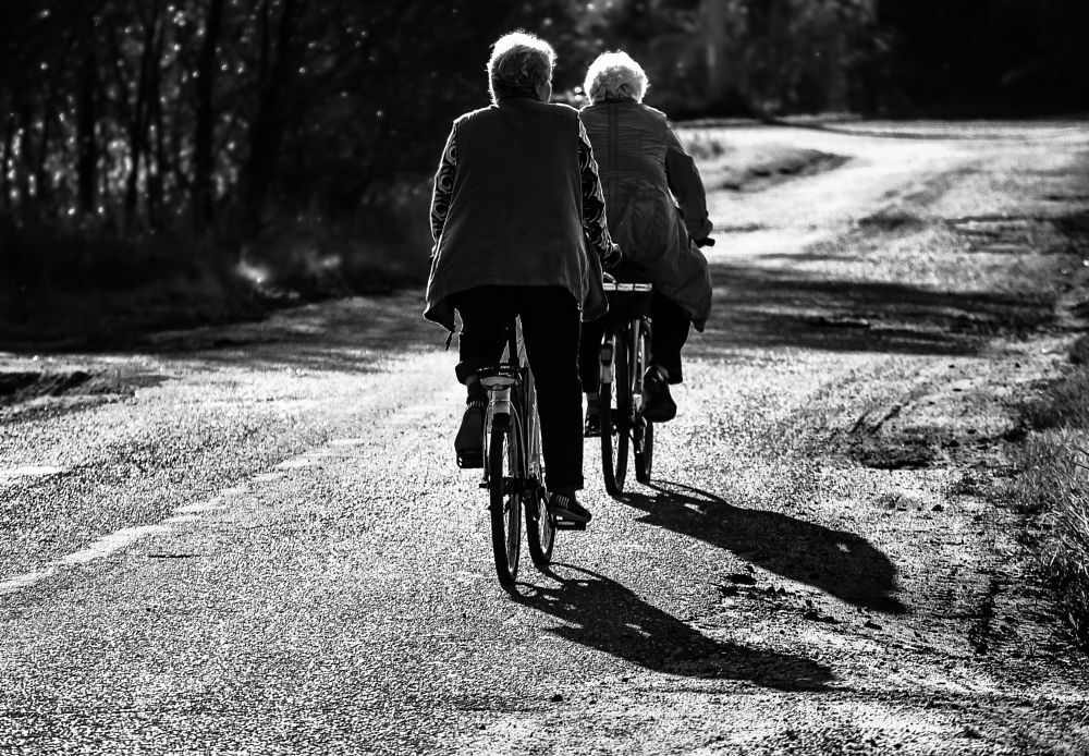 Photo in Street Photography #bike #black and white #road #ridding #street