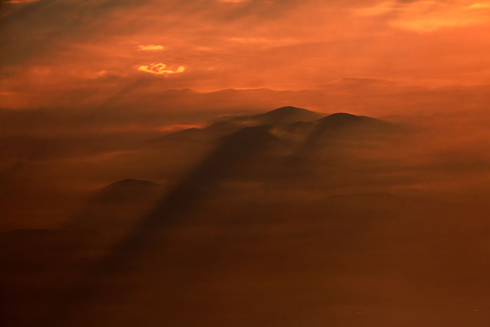 Photo in Landscape #sky #red #orange #peak #mount #mountain #shadows #clouds #rays #sunrise #dawn #high point of view