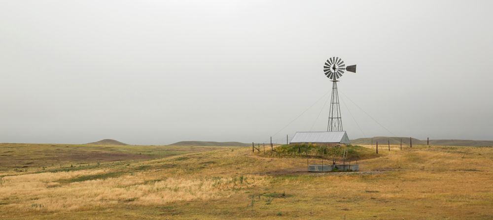 Photo in Landscape #colorado #co #weld county colorado #weld county #colroado's eastern plains #high plains #prairie #windmill #cattle tank #tank #water