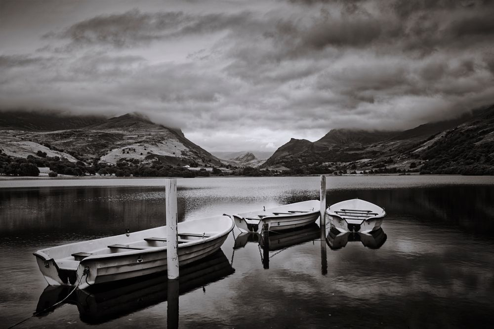 Photo in Black and White #moody #water #lake #mountains #snowden #boats