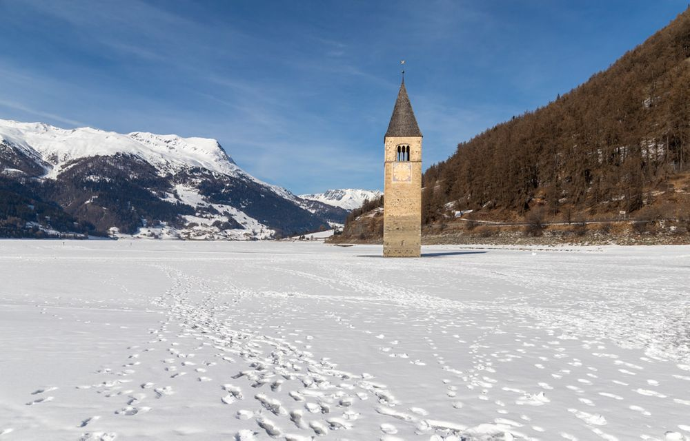 Photo in Travel #resia #tower #submerged #winter #show #lake #frozen