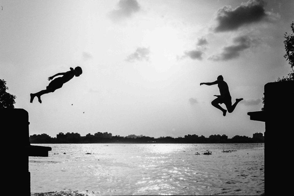 Photo in Black and White #monochrome #street photography #child #diving #kolkata #india #life