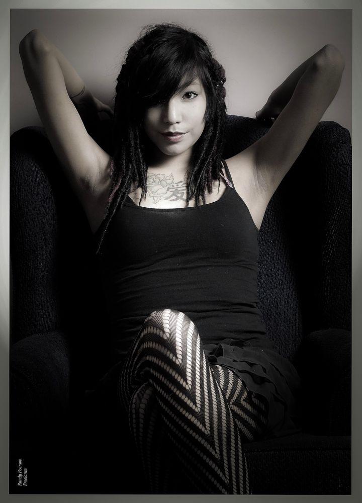 Photo in Portrait #chair #fishnet stockings #little black dress #cute #model #beauty #dreads