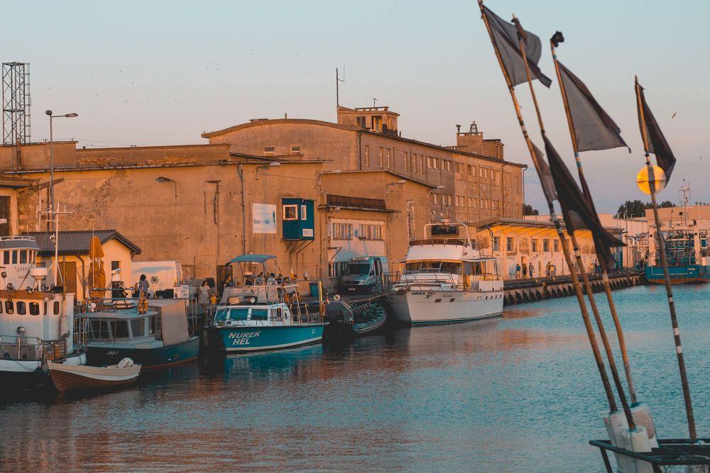 Photo in Travel #boats #sea #sunset #blackflags #tealandorange