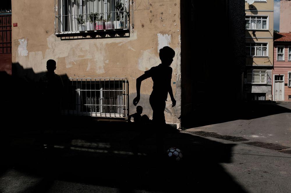 Photo in Street Photography #street #football #light #dark #life #city