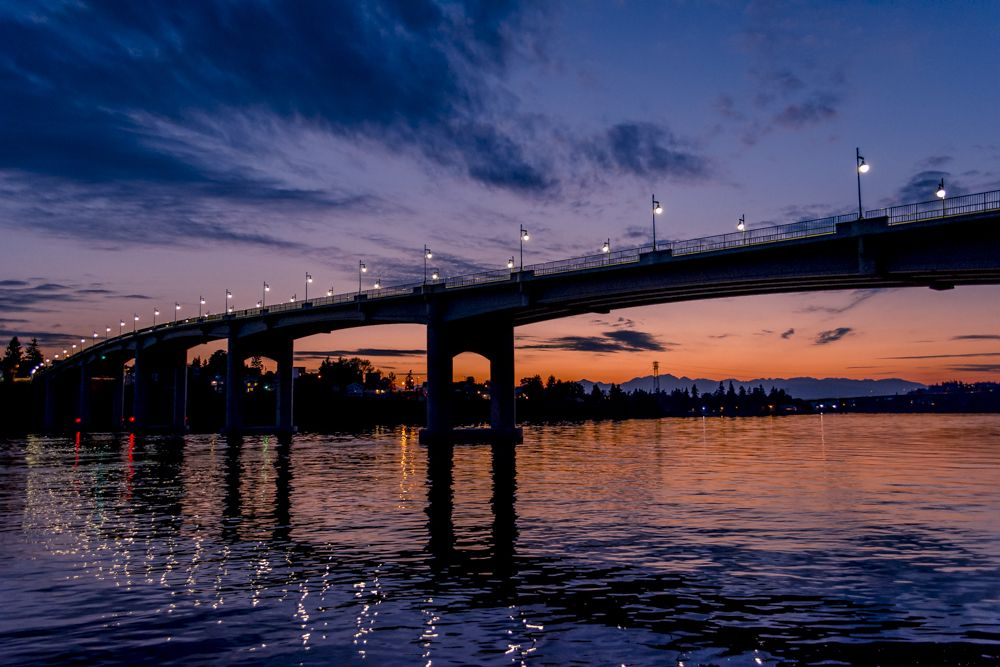 Photo in Architecture #bridge #sunset #architecture #outdoor #clouds #river #water