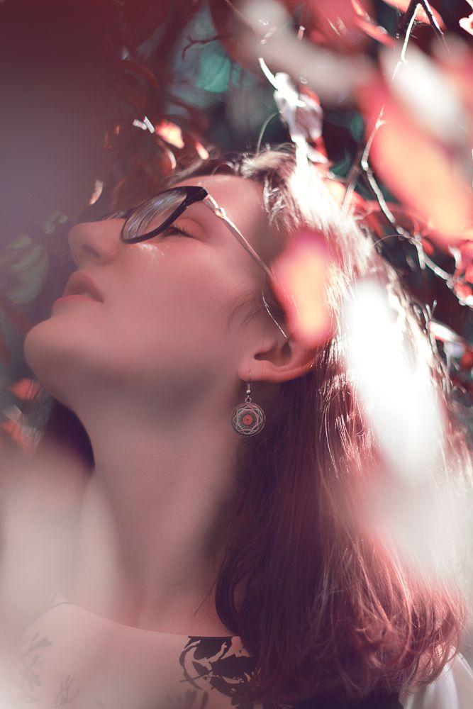 Photo in Portrait #female #portrait #nature #closeup #fashion #outdoors #sunlight #glasses #vintage #earrings #colorful