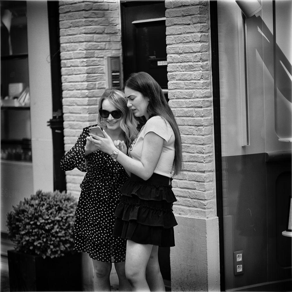 Photo in Black and White #girls #polka #dot #mini #city #street #urban #mono #monochrome #bw #black and white #antwerp #belgium