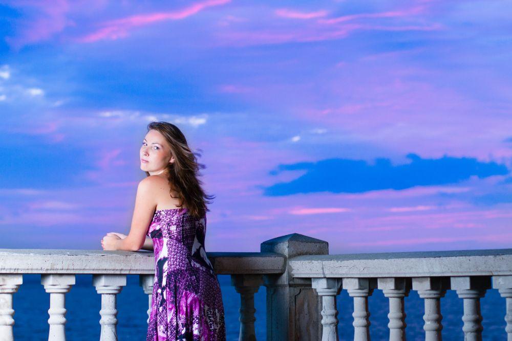 Photo in People #girl #woman #sky #purple #pink #blue #dress #sea #water #clouds #wind