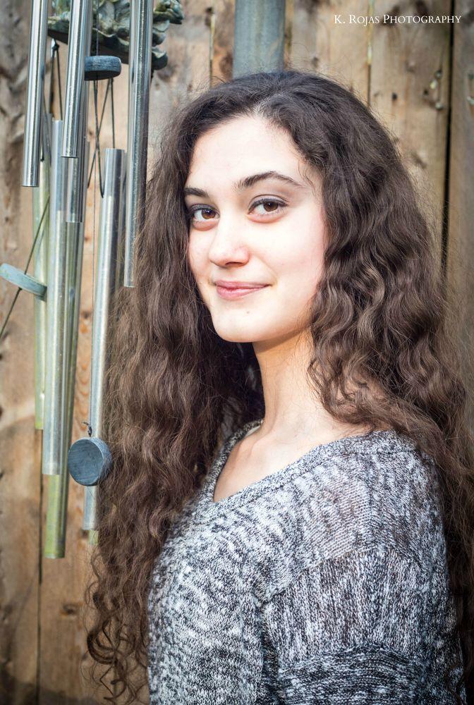 Photo in Portrait #beautifulgirl #windchimes #curlyhair #browneyedgirl