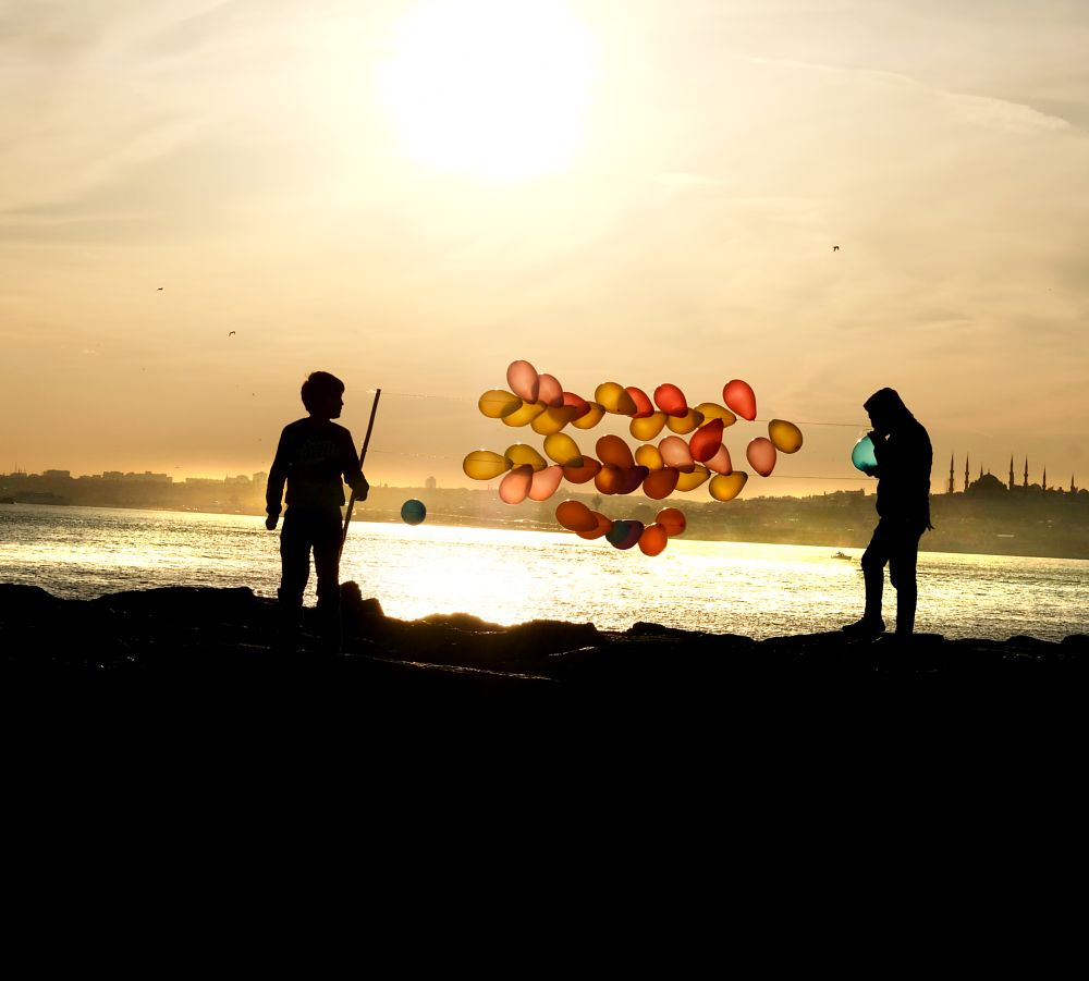 Photo in Street Photography #sunset #balloon #color #evening #world #istanbul #turkey #blue #red #yellow #dark #sun