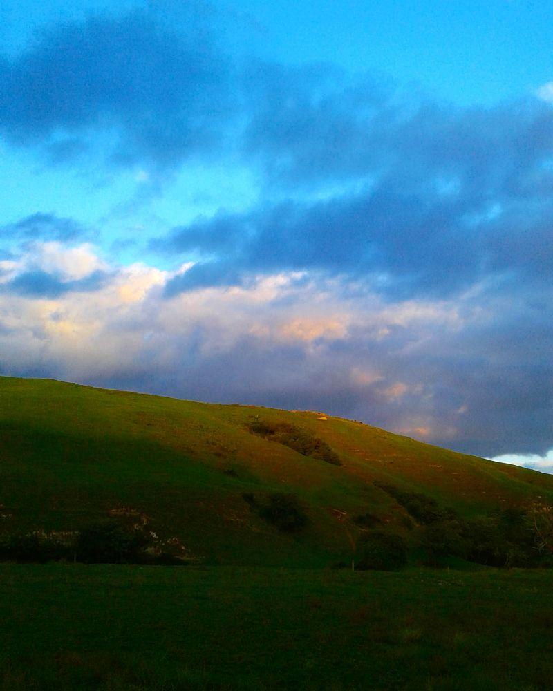 Photo in Landscape #evening #sunshiningonhills #clouds