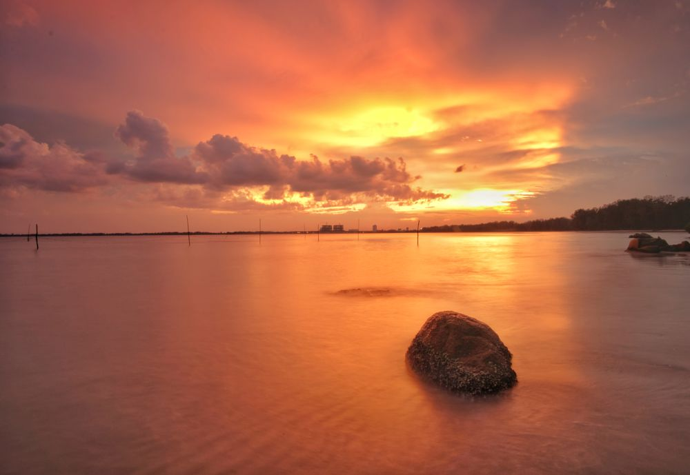 Photo in Sea and Sand #sunset #beach #yellow #stone #black #orange #long exposure #smooth #cloud #seascape