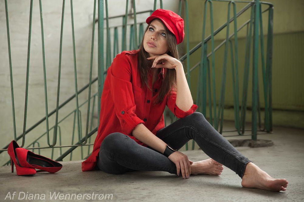 Photo in People #model #girl #red #fashion #hat #shoes #feet #stairs #shirt #jeans #woman