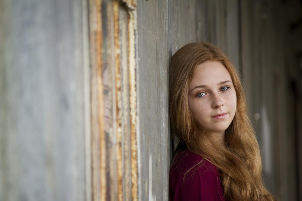 Photo in Portrait #senior portrait #senior #rustic #metal building #red hair #reflection