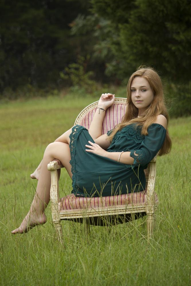 Photo in Portrait #senior portrait #outdoors #chair #elegant #green field #green dress #red hair