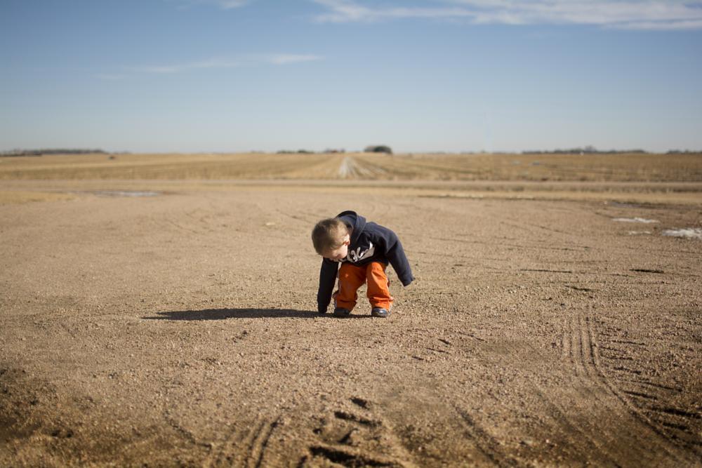 Photo in People #boy #field #country #exploring #rocks #farm