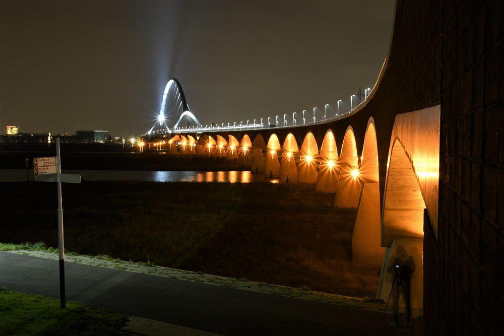 Photo in Cityscape #oversteek #waal #nijmegen #netherlands #evening #lights #dark #crossing #bridge