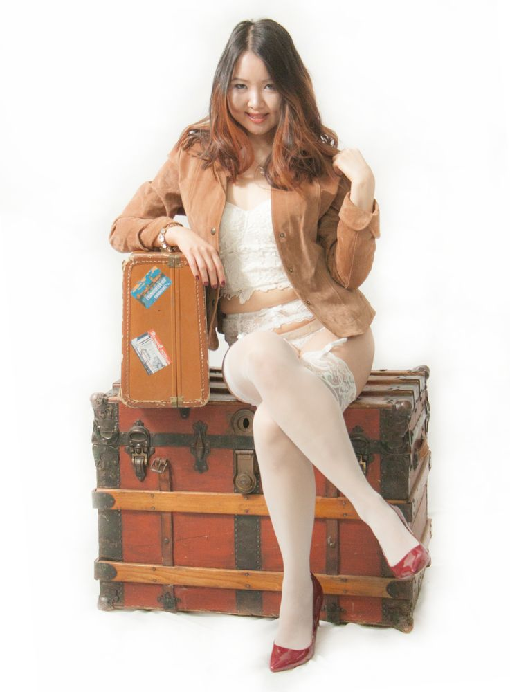 Photo in Fashion #antique trunk #antique suitcase #red shoes #high heels #nylons #garter belt #bralette #leather jacket #long hait #smile #cute #glamour #figure #appealing #smileing #young #woman
