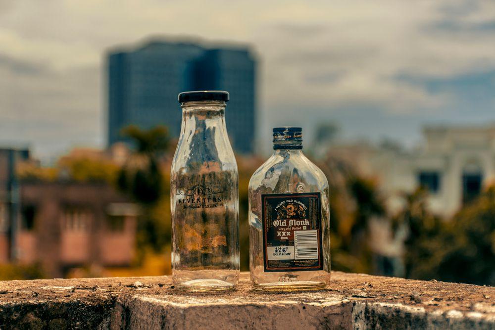 Photo in Random #bottle #alcohol #milk shake #object #glass #childhood #adulthood #ledge #bokeh #blur #photoshop #lightroom #concept #india #kolkata #blue sky #clouds #old monk #booze #rum