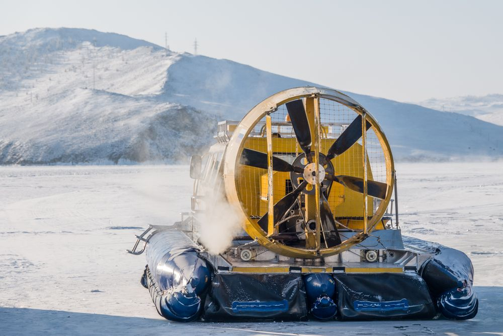 Photo in Travel #winter #cold #hovercraft #fan #yellow #blue #white #ice #water #frozen #lake #siberia #siberian #air #smoke #landscape #travel #transport #light #clear #sunny #sun #pinklight #adventure #north #snow #freezing #fun