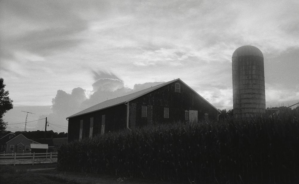 Photo in Black and White #clouds #canon #canonet #black and white #landscape #farm #kodak film #film photograpghy #kodak plus x 125 #rangefinder photography #country living