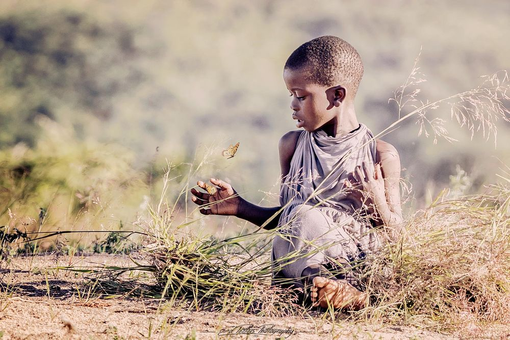 Photo in People #butterfly #africa #malawi #girl #chitimba #edpeetersphotography