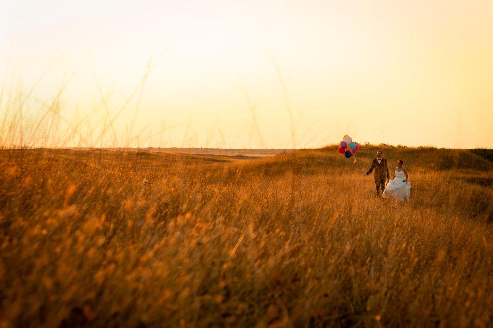 Photo in Wedding #bride #groom #wedding #field #sunset #walking #sunrise #twilight #dusk #dawn #balloon #grass #love #couple #nature #outdoors #landscape #horizon #man #woman #dress #canon