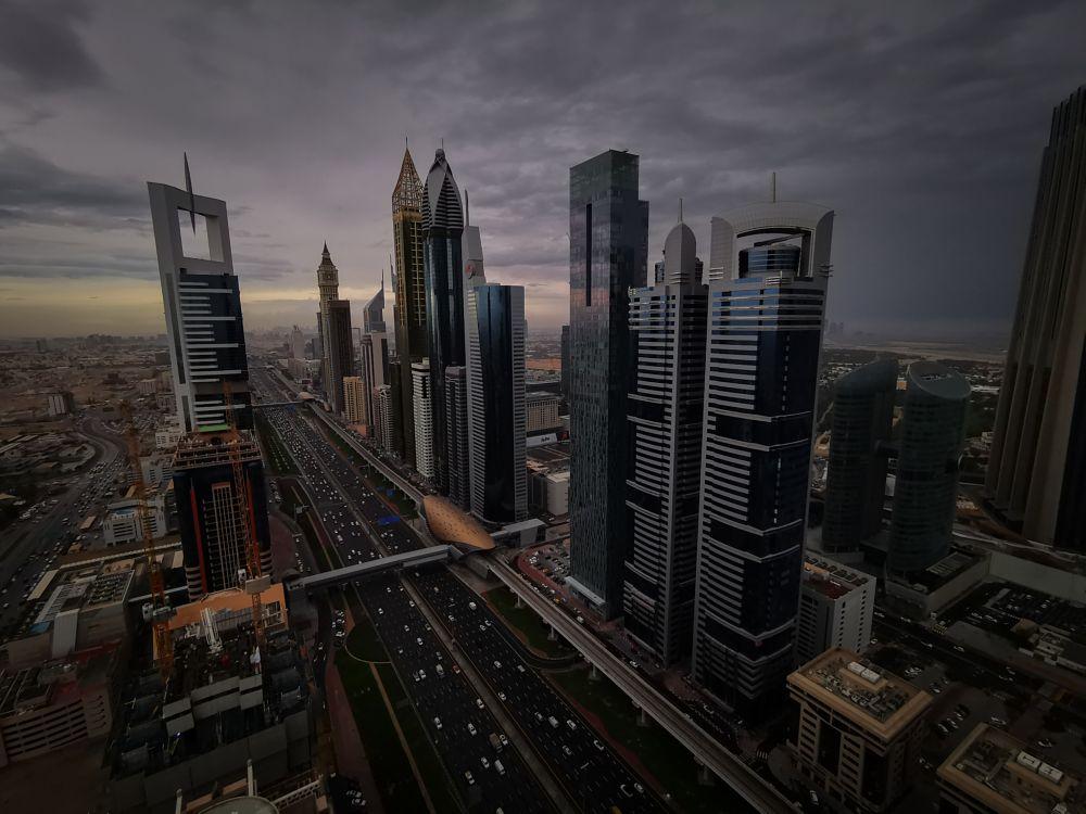 Photo in Random #dubai #cityscape #city #road #financial district #storm #clouds #building #photography