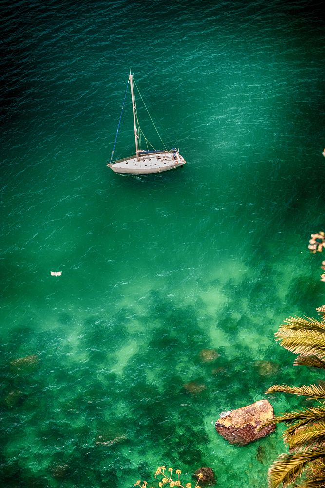 Photo in Sea and Sand #sea #coast #sail #harbour #green #emerald #mare #summer #blue #boat #rocks