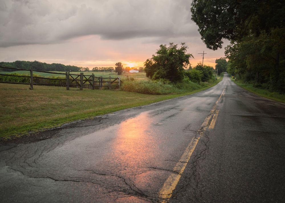 Photo in Sea and Sand #rain #sunrise #sun #road #morning #clouds #fence #landscape #nikon #photography