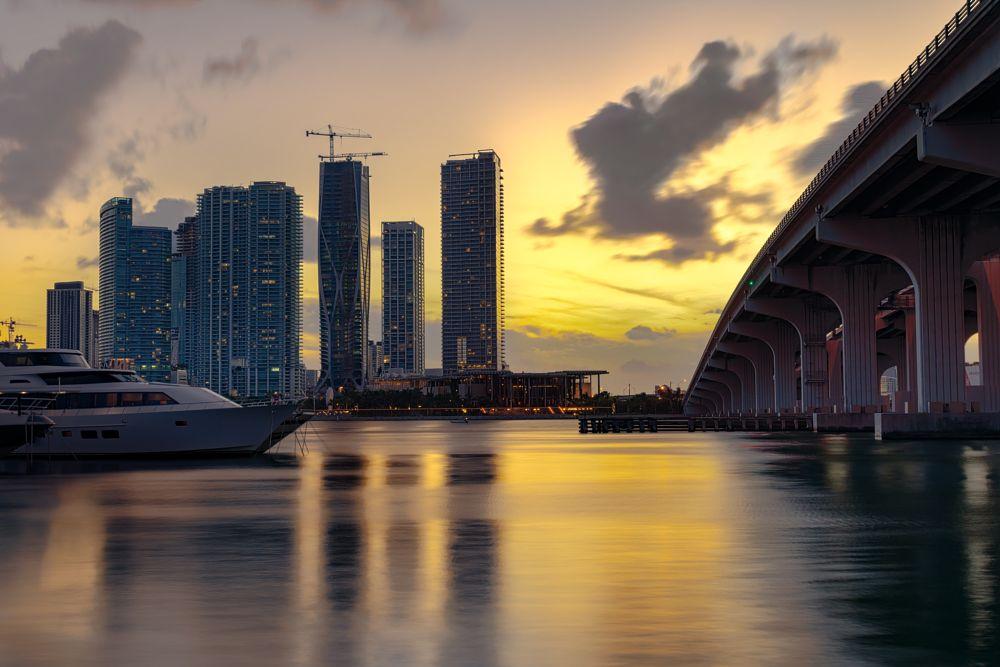 Photo in Landscape #bridge #water #sea #long exposure #boat #sunset #colors #sky #skyscraper