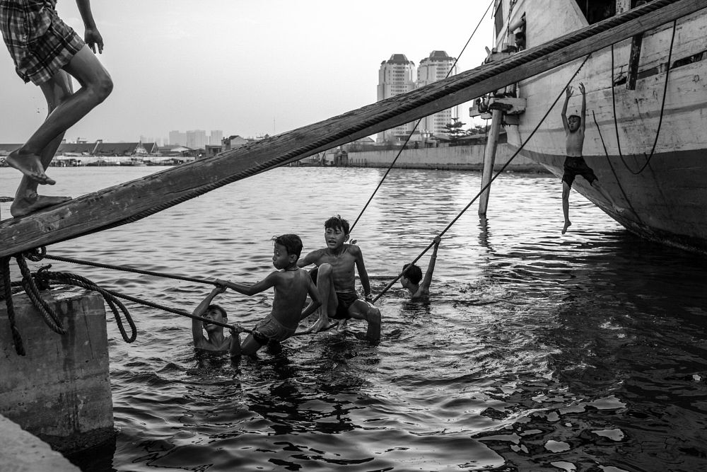 Photo in Street Photography #children #kids #playing #black and white #sunda kelapa #port
