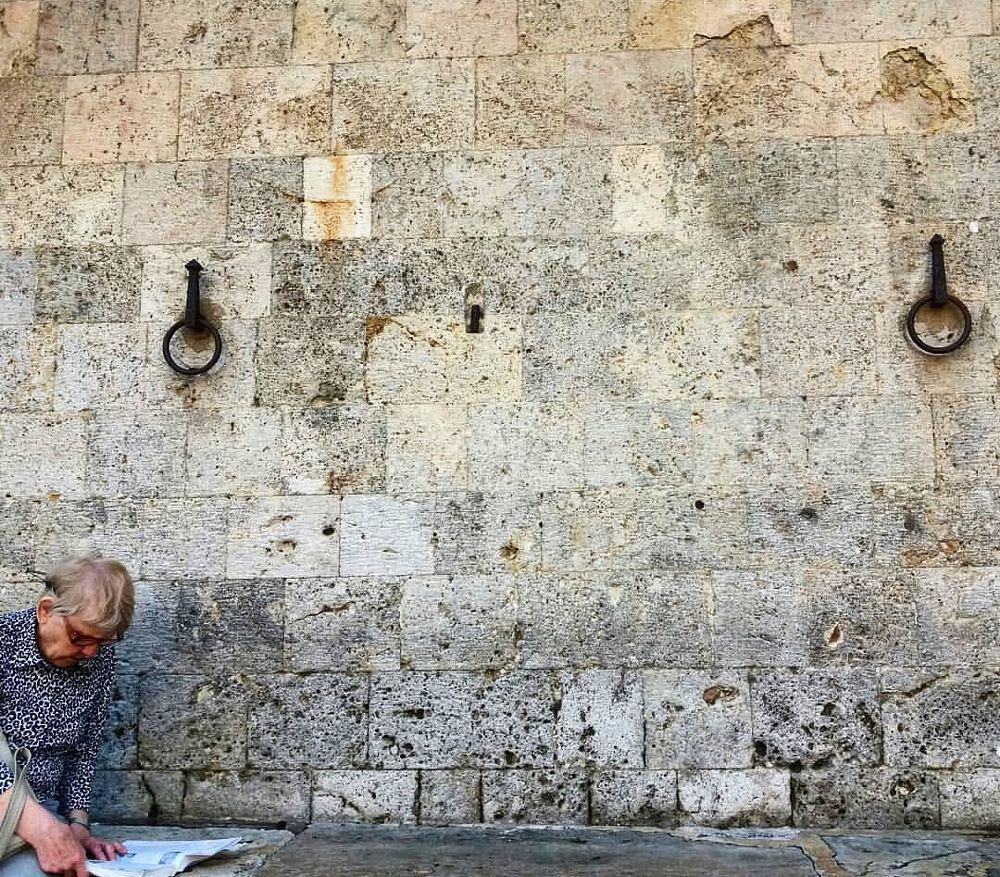 Photo in Random #toscana siena wall man cas