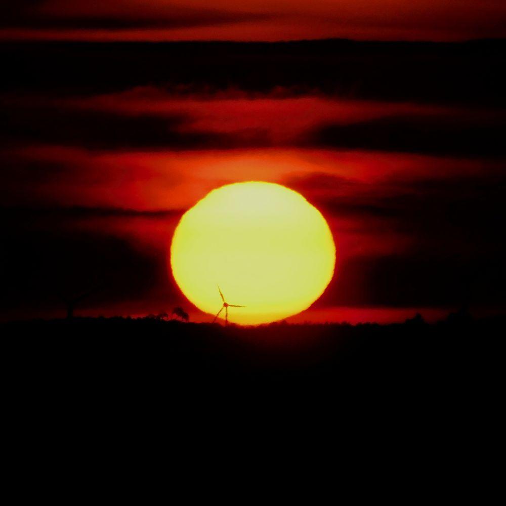 Photo in Random #sun #sunset #circle #sky #silhouette #wind power plant