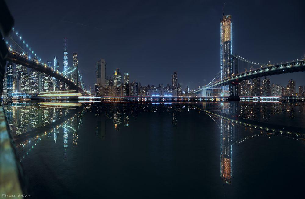 Photo in Cityscape #manhattan #brooklyn #bridges #new york city #panorama #reflection #cityscape #color #long exposure #night
