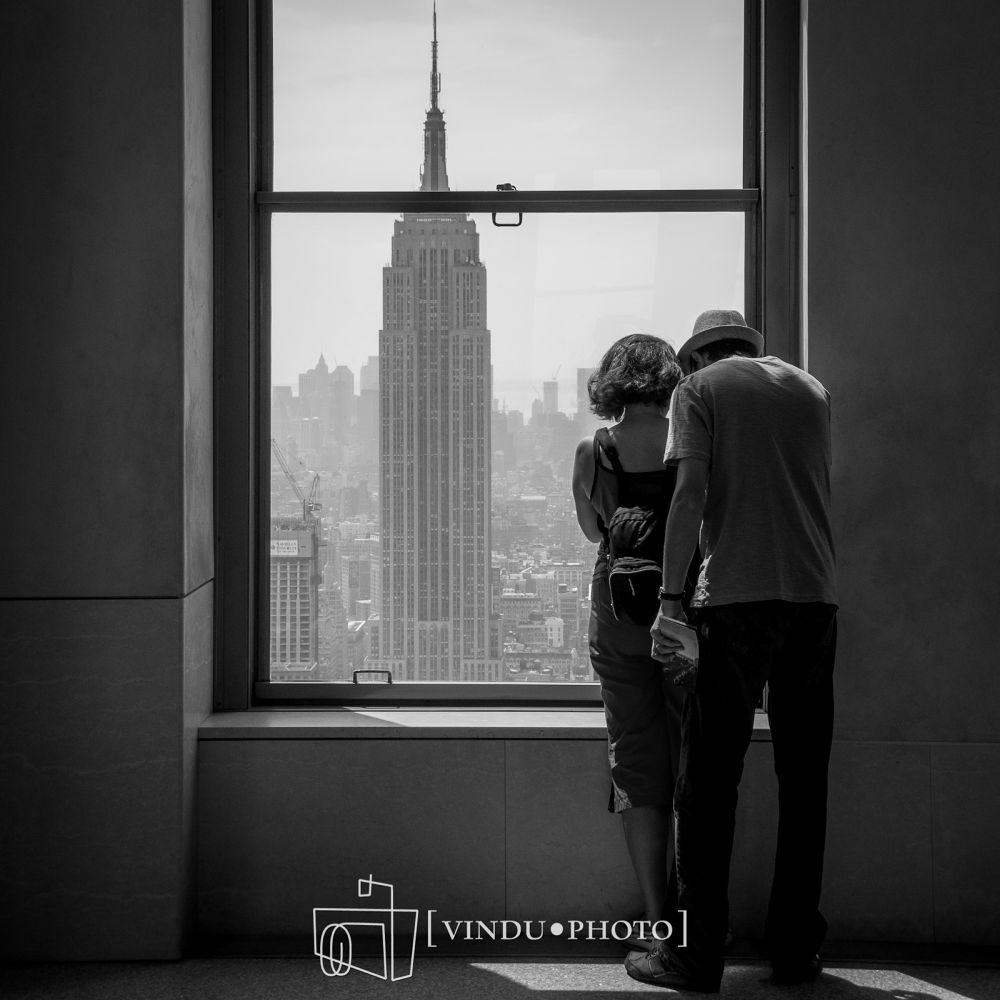 Photo in Random #street #window #b&w #couple #new york city #empire state building #top of the rock