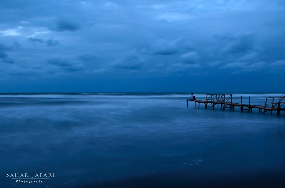 Photo in Landscape #blue #boy #clouds #long exposure #night #night photography #sea #solitude