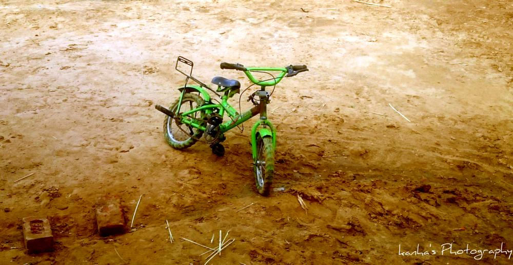 Photo in Street Photography #childhood #bicycle #little #india